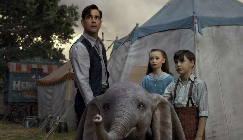 "This image released by Disney shows Colin Farrell, Nico Parker and Finley Hobbins in a scene from ""Dumbo."" (Disney via AP) Photo: Associated Press / Disney"