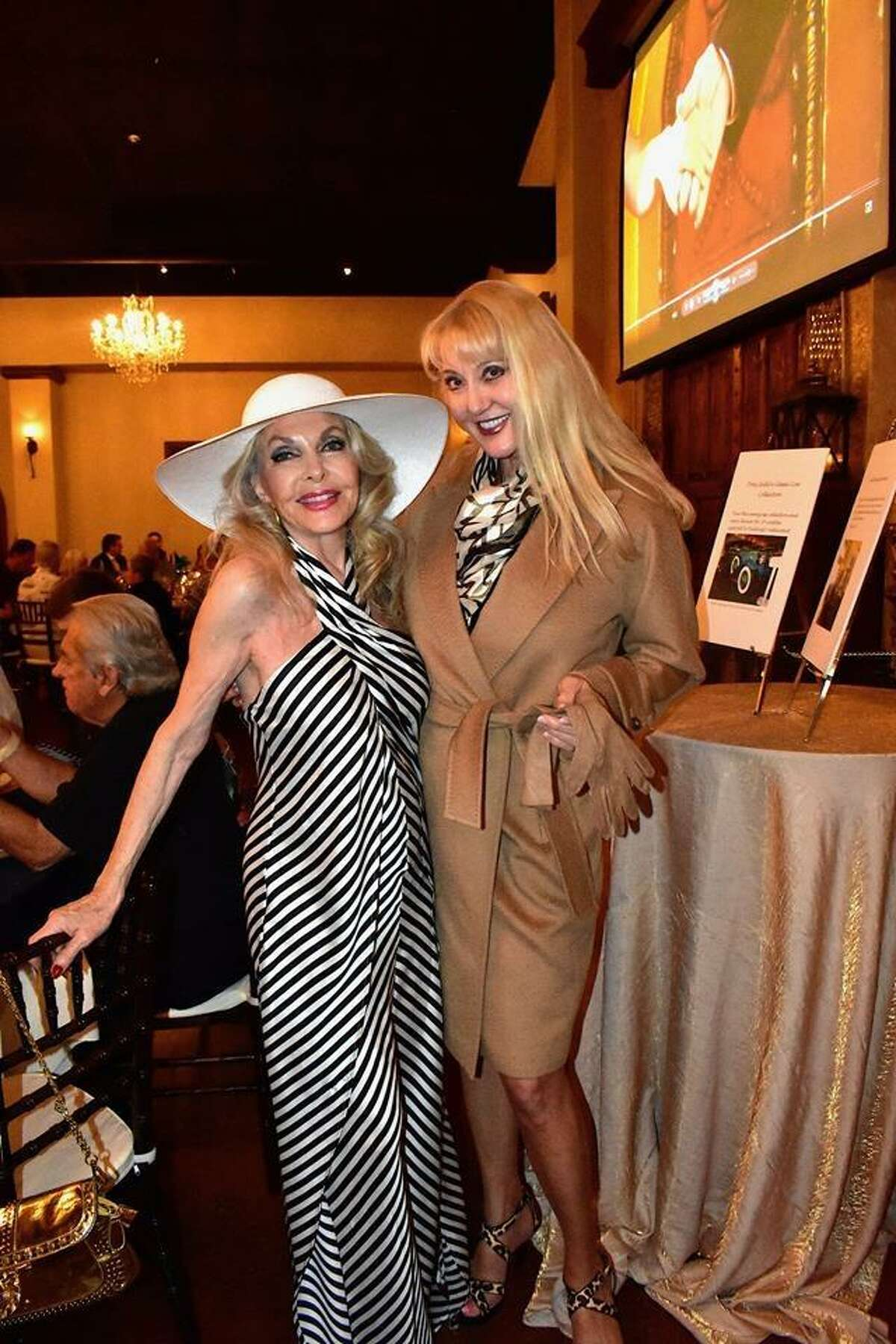 """Lyn Howard and Lorraine Counts at the Crighton Theatre fundraiser """"Anchors Aweigh"""" on March 28 at Madera Estates in Conroe. Counts modeled a cashmere coat that was auctioned off as a part of the fundraiser."""
