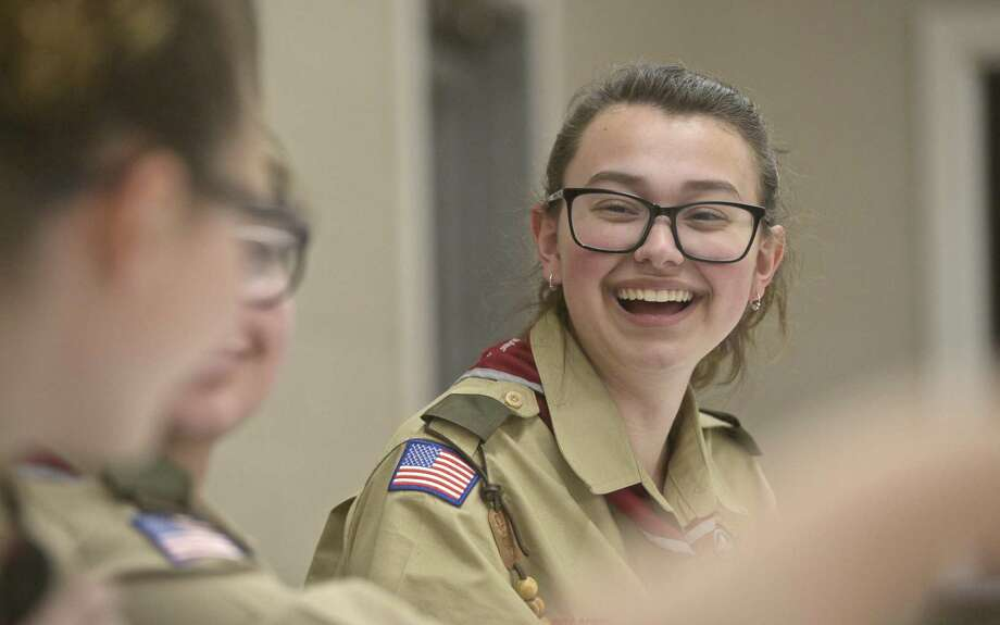 Emma Cedusky, 17, senior patrol leader of Boy Scout troop 306, the first all-female Boy Scout troop in Redding, talks with other troop members. Tuesday, April 2, 2019, at the West Redding Volunteer Fire Department, Redding, Conn. Photo: H John Voorhees III / Hearst Connecticut Media / The News-Times