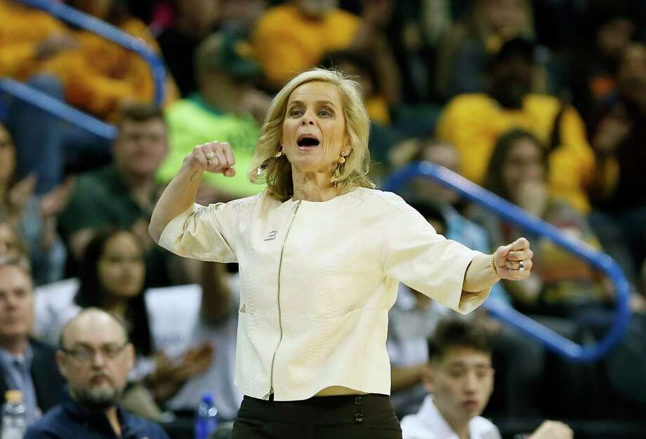 PHOTOS: Women who broke ground in male-dominated sports  FILE - In this March 10, 2019, file photo, Baylor head coach Kim Mulkey reacts after a Baylor basket against Kansas State during the first half of an NCAA women's college basketball game in the Big 12 women's conference tournament, in Oklahoma City. Mulkey was named The Associated Press Coach of the Year, Thursday, April 4, 2019. (AP Photo/Alonzo Adams, File)  >>>See the women who have gained ground in the world of male-dominated sports ...  Photo: Alonzo Adams, Associated Press / Copyright 2018 The Associated Press. All rights reserved.