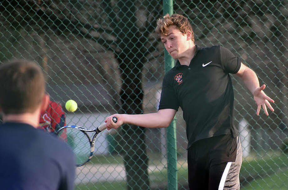 Edwardsville's Nick Hobin hits a forehand shot during No. 3 doubles with Ben Blake during a regular season match against O'Fallon.