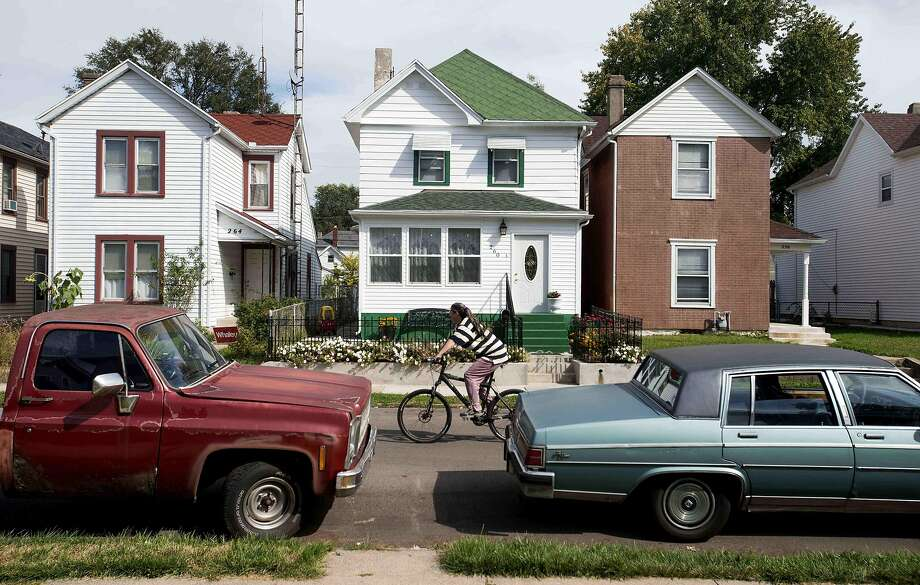 The homes in Dayton, Ohio, were restored as part of an economic program attracting immigrants to the neighborhood. Photo: Ty William Wright / New York Times 2013