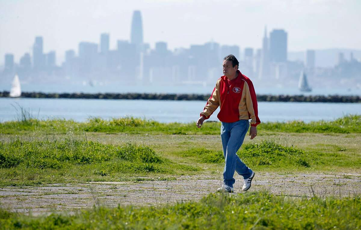 A visitor walks on a path at Miller/Knox Regional Shoreline in Richmond, Calif. on Saturday, March 30, 2019. The East Bay Regional Park District wants to remove some long abandoned sections of railroad tracks but the BNSF Railway Company wants to reactivate a portion of the spur.