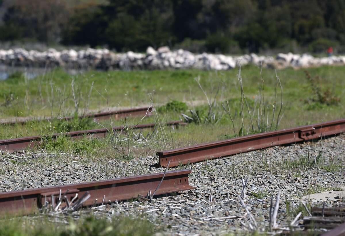 Disconnected sections of railroad track leading from an old railway terminal remain at Ferry Point of the Miller/Knox Regional Shoreline in Richmond, Calif. on Saturday, March 30, 2019. The East Bay Regional Park District wants to remove some abandoned sections of railroad tracks but the BNSF Railway Company wants to reactivate a portion of the spur.