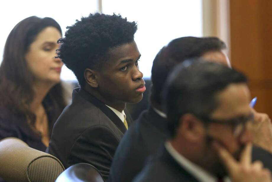Antonio Armstrong, Jr., center, listens to opening arguments by prosecutors inside 178 Criminal Courthouse Tuesday, April 2, 2019, in Houston. Armstrong Jr. faces capital murder charges for allegedly murdering his parents in their Bellaire home in 2016. (Godofredo A. Vasquez/Houston Chronicle via AP) Photo: Godofredo A. Vasquez, MBO / Associated Press / 2018 Houston Chronicle