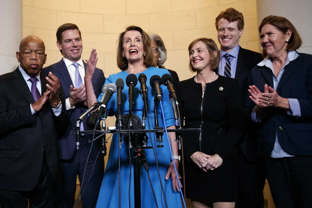 House Minority Leader Nancy Pelosi, D-Calif., joined by from left, Rep. John Lewis, D-Ga., Rep. Eric Swalwell, D-Calif., Rep. Joyce Beatty, D-Ohio., Rep. Kathy Castor, D-Fla., Rep. Joe Kennedy, D-Mass., and Rep. Ann Kirkpatrick, D-Ariz., speaks to media at Longworth House Office Building on Capitol Hill in Washington, Wednesday, Nov. 28, 2018, to announce her nomination by House Democrats to lead them in the new Congress. She still faces a showdown vote for House speaker when lawmakers convene in January. (AP Photo/Carolyn Kaster)