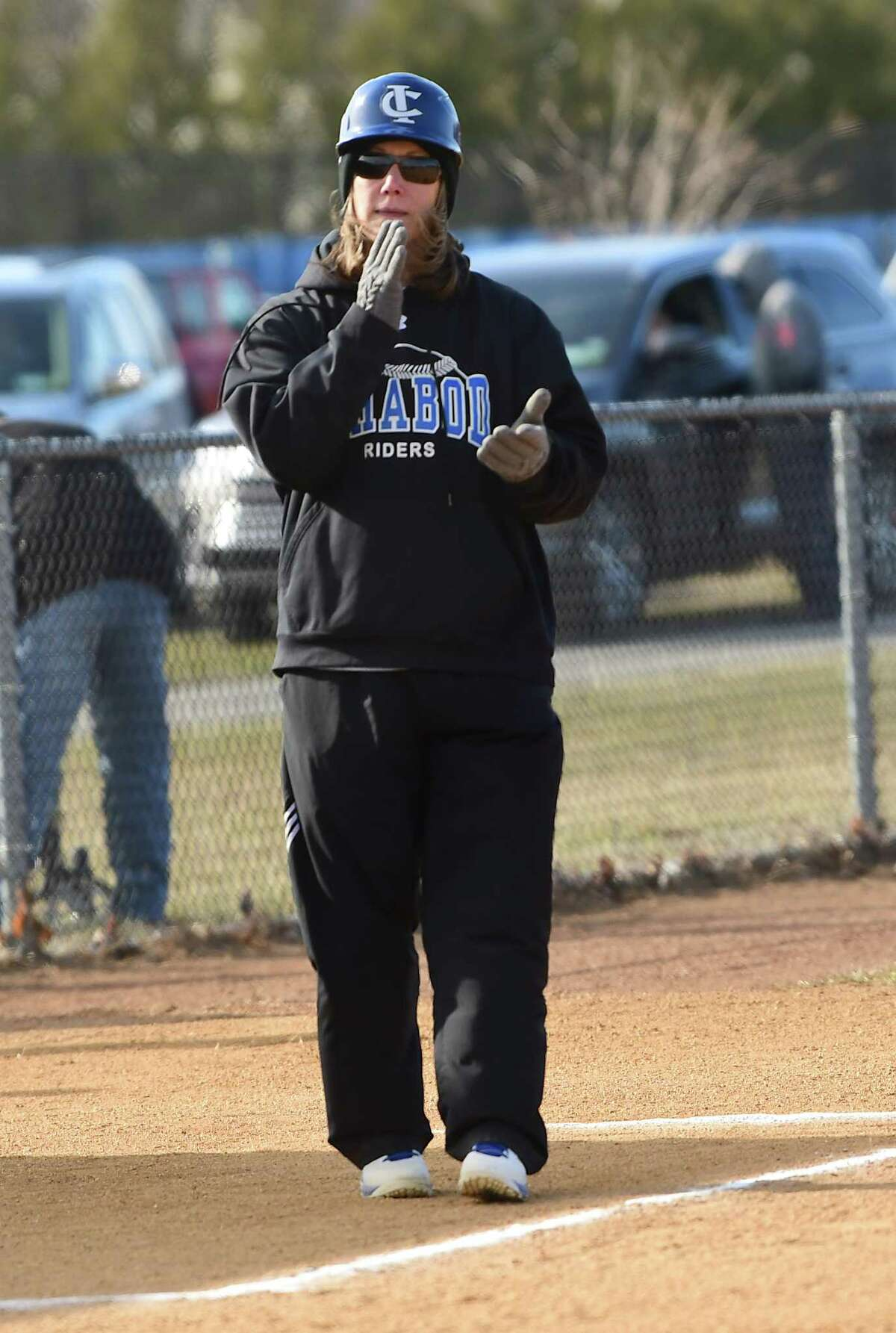 Ichabod Crane coach Tracy Natransky gives signals to a batter during a softball game against Holy Names on Thursday, April 4, 2019 in Valatie, N.Y. (Lori Van Buren/Times Union)