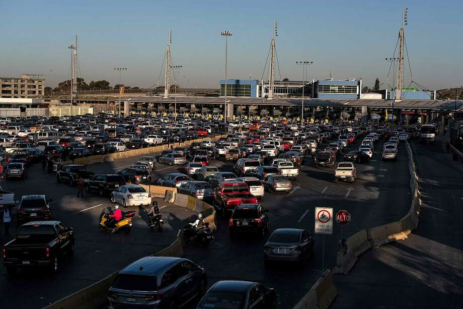 In this file photo taken on November 9, 2018, cars line up to cross to the United States at San Ysidro port of entry, as seen from Tijuana. Photo: Guillermo Arias, AFP/Getty Images