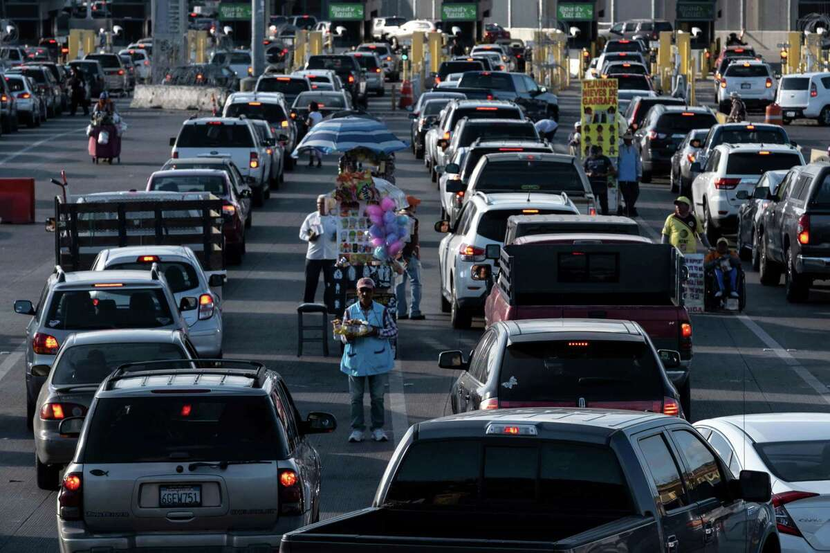 Cars line up to cross to San Diego from Tijuana, Mexico at the San Ysidro crossing port in in Baja California state on April 2.