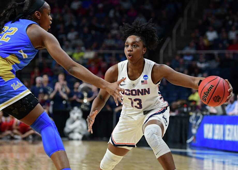 UConn's Christyn Williams looks to make a move to the net against UCLA's Kennedy Burke during the Albany Regional semifinals at the Times Union Center on March 29 in Albany, N.Y. Photo: Lori Van Buren / Albany Times Union / 40046482A