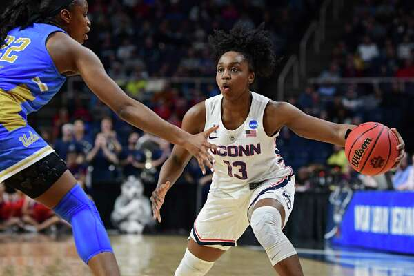 UConn's Christyn Williams looks to make a move to the net against UCLA's Kennedy Burke during the Albany Regional semifinals at the Times Union Center on March 29 in Albany, N.Y.