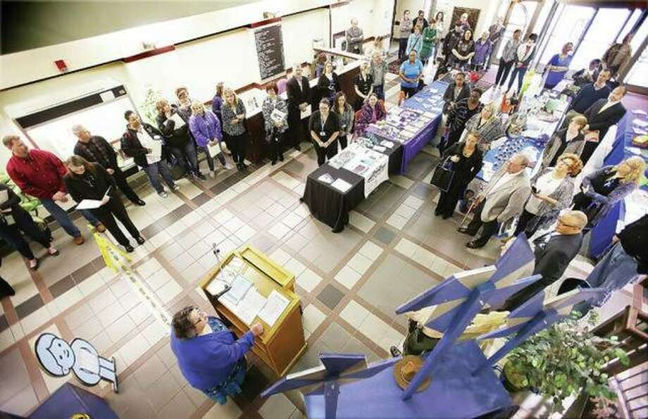 A small crowd fills the lobby of the Madison County Administration Building for the kickoff of Child Abuse Awareness Month in 2017. Photo: John Badman   Hearst Illinois