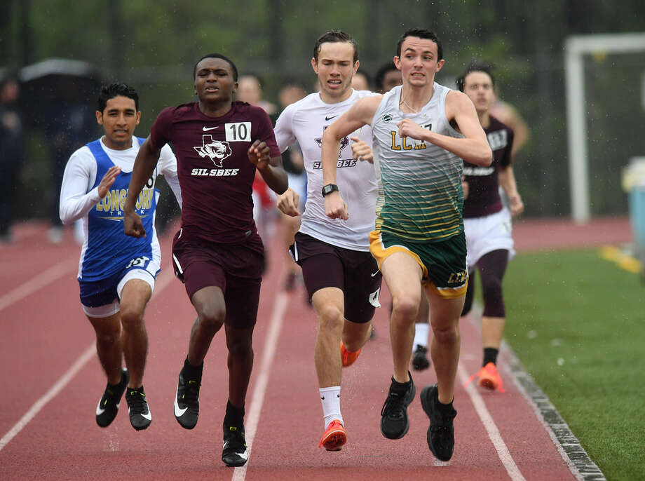 Little Cypress-Mauriceville's Eli Peveto, right, takes first place in the 800 meter during Thursday's district track meet at Lumberton High School. Photo taken Thursday, 4/4/19 Photo: Guiseppe Barranco / The Enterprise