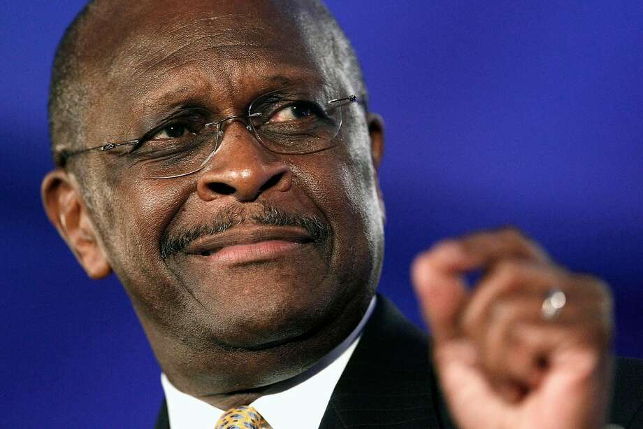 """FILE - In this Friday, June 17, 2011  file photo, Republican presidential candidate Herman Cain speaks at the Republican Leadership Conference in New Orleans. Appearing on """"Fox News Sunday"""" on Sunday, July 17, 2011, Cain said that communities have a right to ban Islamic mosques. Cain said his view doesn't amount to religious discrimination because he says Muslims are trying to inject Shariah law into the U.S. (AP Photo/Patrick Semansky, File) Photo: Patrick Semansky, AP"""