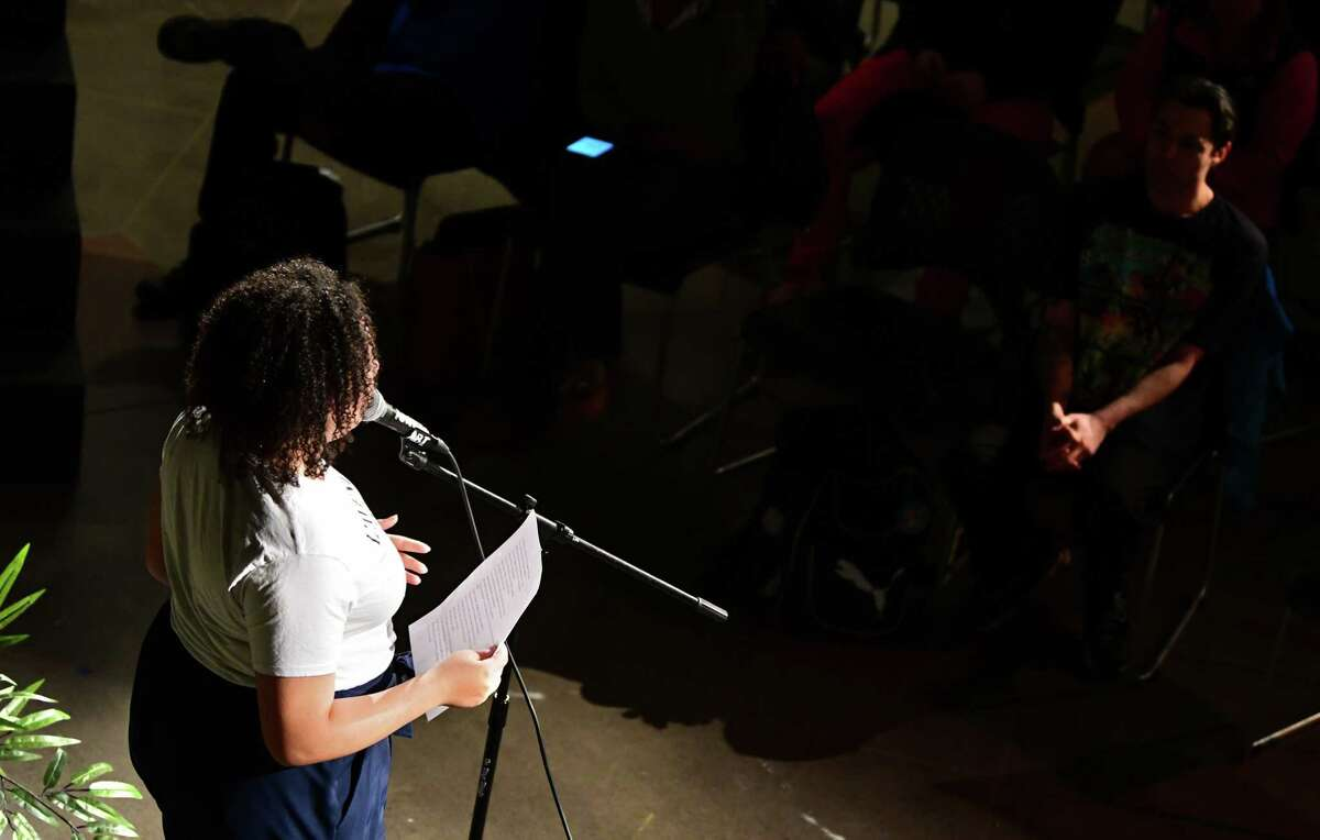 A participant introduced as Sarah reads a poem during CapCity Slam at the Albany Barn on Wednesday, April 3, 2019 in Albany, N.Y. (Lori Van Buren/Times Union)