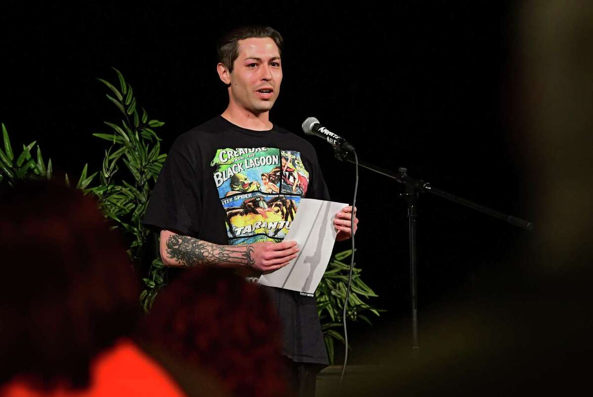Gregory Wilder of Schenectady reads a poem about being addicted to poetry during CapCity Slam at the Albany Barn on Wednesday, April 3, 2019 in Albany, N.Y. (Lori Van Buren/Times Union)