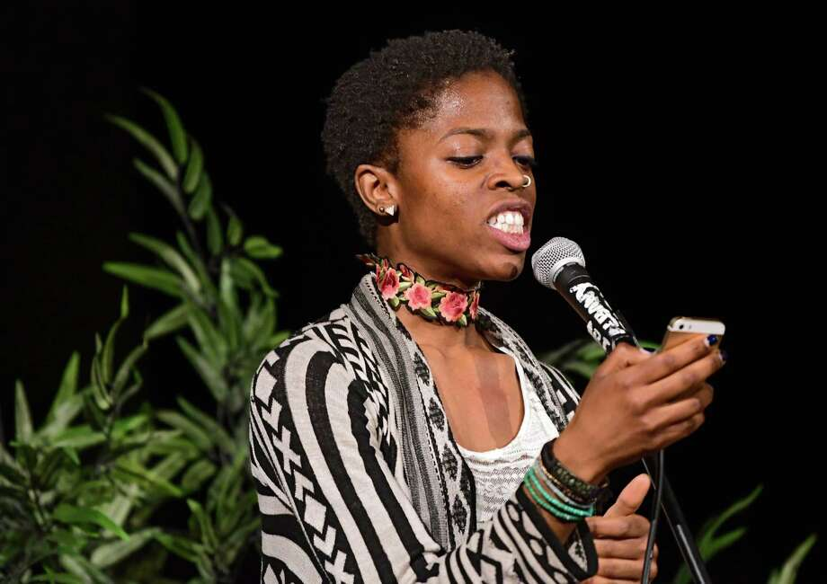Host Amani Olugbala reads a poem she wrote during CapCity Slam at the Albany Barn on Wednesday, April 3, 2019 in Albany, N.Y. (Lori Van Buren/Times Union) Photo: Lori Van Buren, Albany Times Union / 40046574A