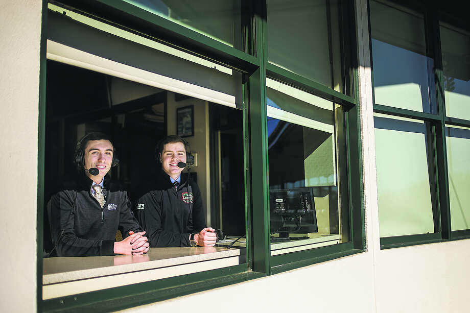 Radio broadcasters Brad Tunney, left, and Blake Froling are shown in the press box at Dow Diamond, where they will call Great Lakes Loons games throughout the season.