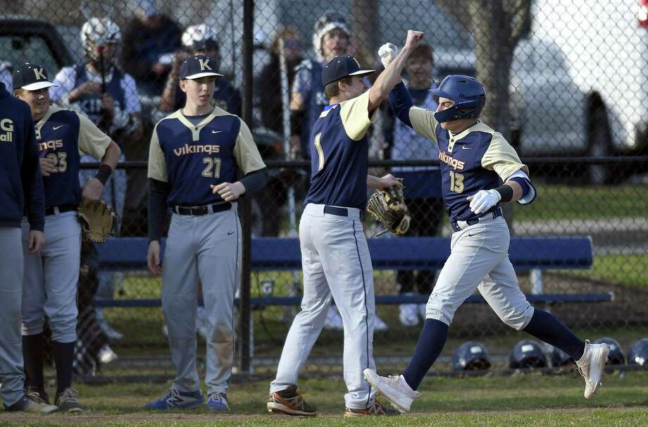 King's Joey Skarad celebrates with Jack Meizels following a three-run homer against Canterbury in the third inning of a baseball game at King School on Thursday in Stamford. King defeated Canterbury 13-9. Photo: Matthew Brown / Hearst Connecticut Media / Stamford Advocate