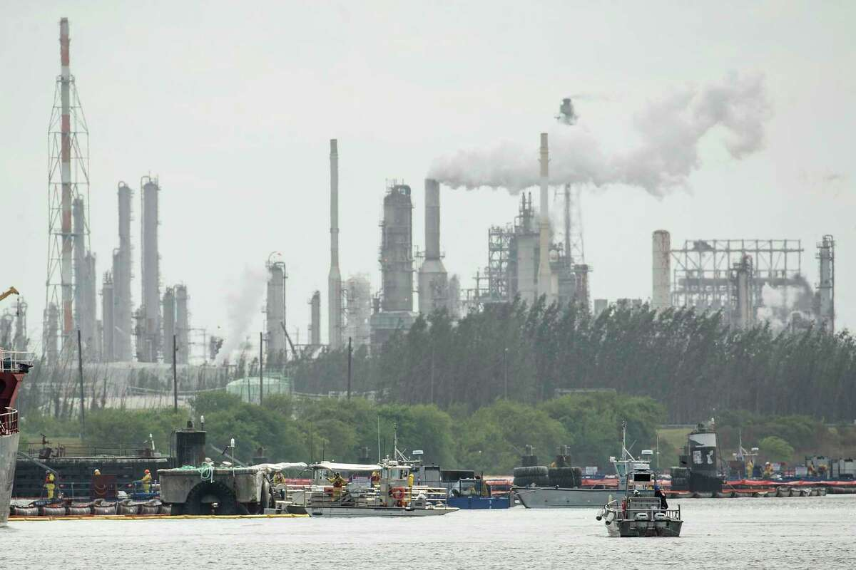 Skimmers work on taking petrochemical products and contaminants out of the water as cleanup continues along the Houston Ship Channel in the aftermath of the tank fire at Intercontinental Terminals Company on Friday, March 29, 2019, in Deer Park.