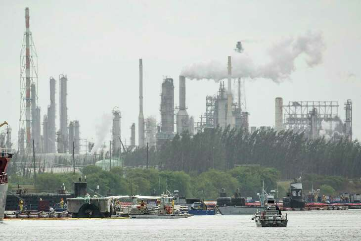 Skimmers work on taking petrochemical products and contaminants out of the water as clean up continues along the Houston Ship Channel in the aftermath of the tank fire at Intercontinental Terminals Company on Friday, March 29, 2019, in Deer Park.