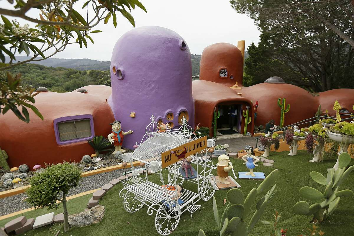 In this photo taken Monday, April 1, 2019, is an exterior view of the Flintstone House in Hillsborough, Calif.