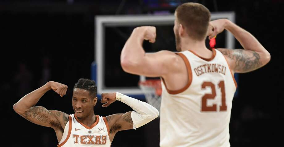 NEW YORK, NEW YORK - APRIL 04: Kerwin Roach II #12 of the Texas Longhorns reacts with teammate Dylan Osetkowski #21 during the first half of the game against the Lipscomb Bisons at Madison Square Garden on April 04, 2019 in New York City. (Photo by Sarah Stier/Getty Images) Photo: Sarah Stier/Getty Images