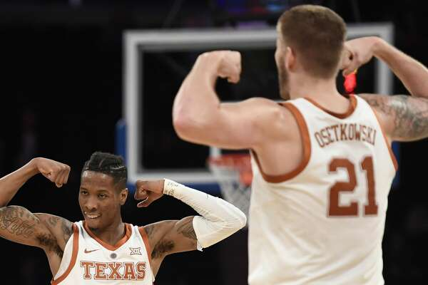 NEW YORK, NEW YORK - APRIL 04: Kerwin Roach II #12 of the Texas Longhorns reacts with teammate Dylan Osetkowski #21 during the first half of the game against the Lipscomb Bisons at Madison Square Garden on April 04, 2019 in New York City. (Photo by Sarah Stier/Getty Images)