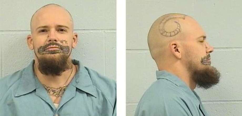 Chase is pictured in a recent photo from Menard Correctional Center with head and facial tattoos he's received in the 5-and-a-half years he's been locked up for the murder of his former girlfriend.