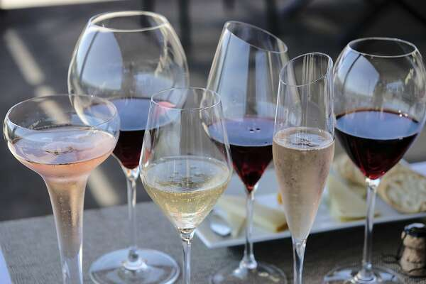 FILE - This Monday, July 10, 2017 file photo shows different shaped glasses of wine in Sonoma, Calif. According to a large genetic study released on Thursday, April 4, 2019, drinking alcohol raises the risk of high blood pressure and stroke, debunking previous claims that moderate drinking was protective. (AP Photo/Eric Risberg)