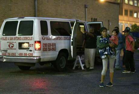 Migrants arrive in downtown San Antonio from Eagle Pass on an Aguila Express bus on Wednesday night, April 3, 2019. Aguila Express is a private company that has allegedly been price gouging the cost of their tickets for migrants between $75 and $100 per person.
