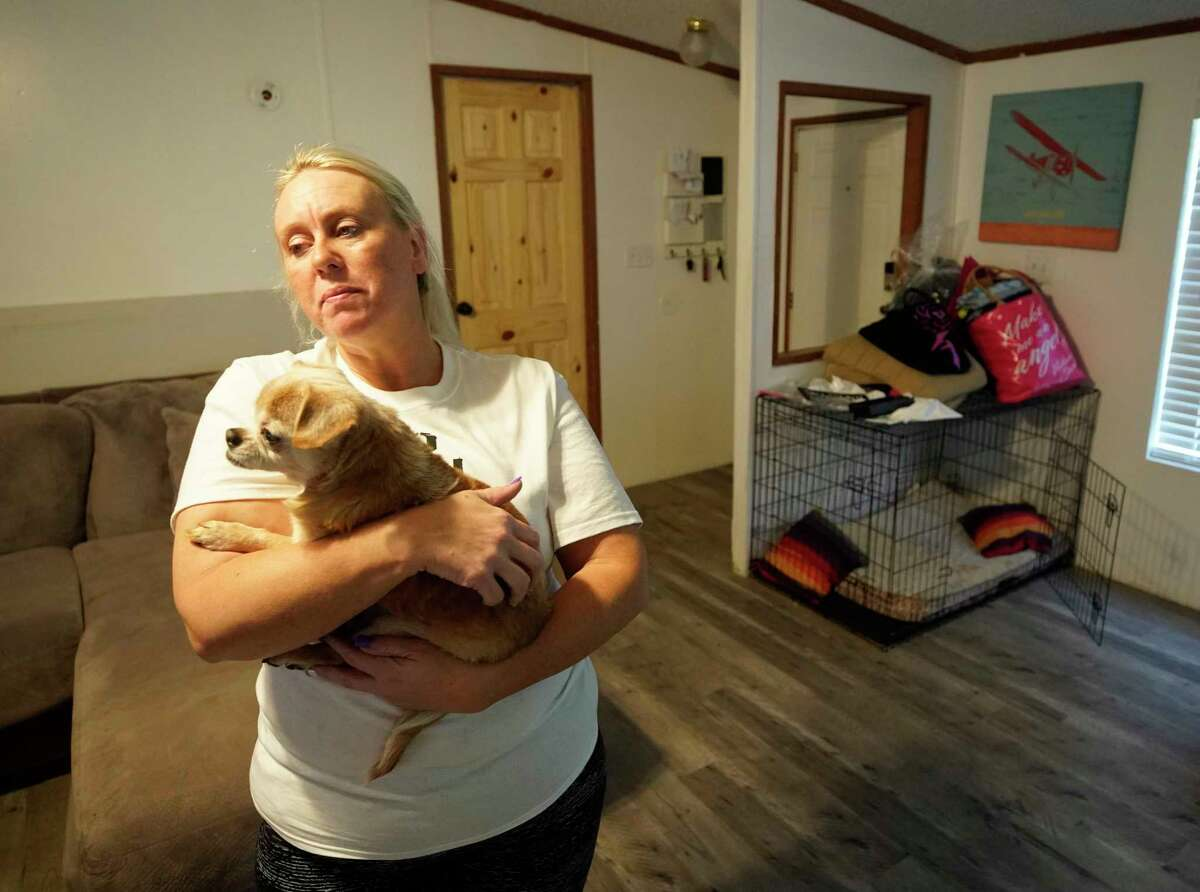 Tammy Young holds her blind dog, Toby, while she visits her home located across the street from the KMCO chemical plant Thursday, April 4, 2019, in Crosby. Her family has not be able to stay in their home since a deadly explosion at plant on Tuesday. She visits her dog, Toby, several times a day.