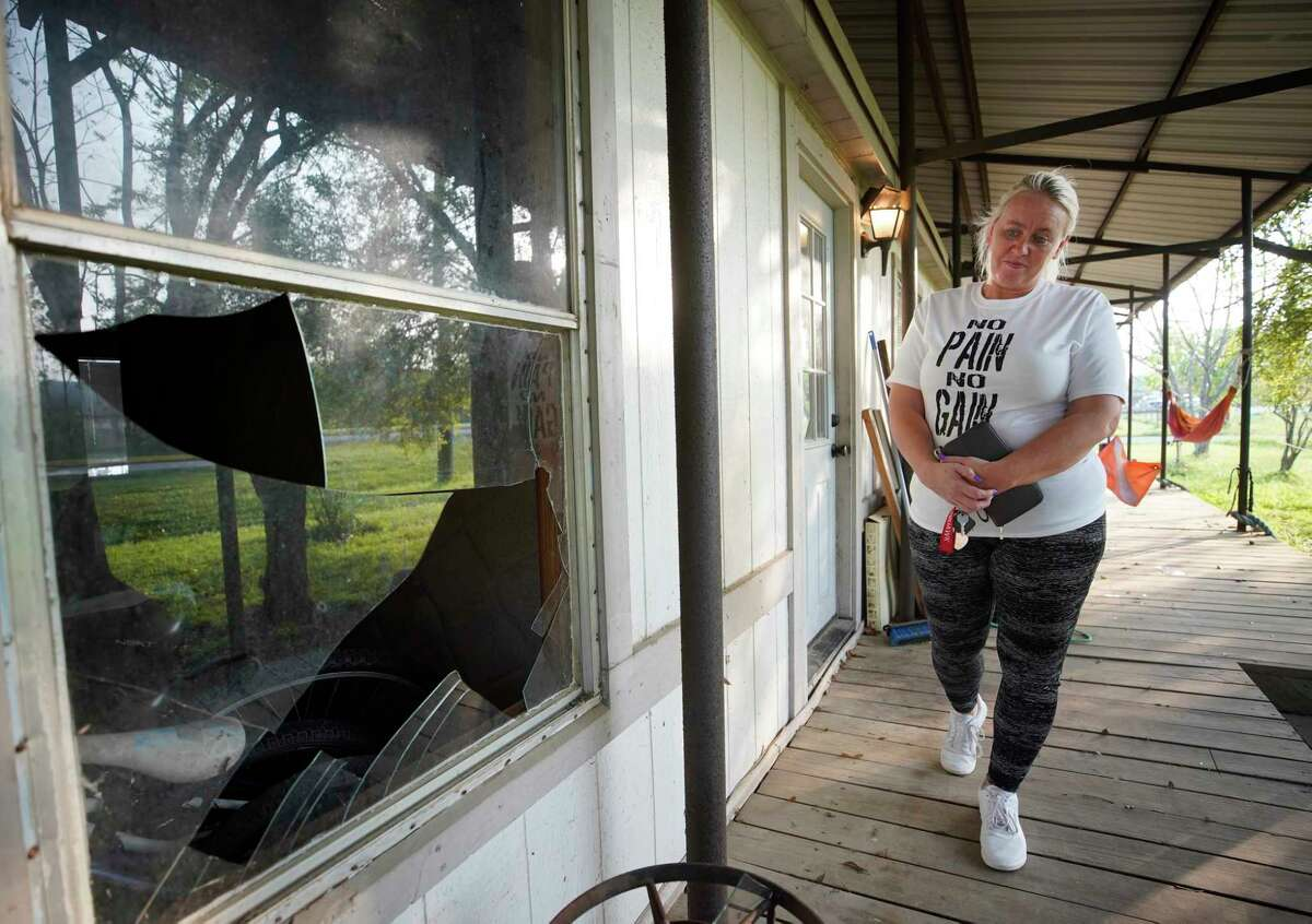 Tammy Young looks at one of the many broken windows on the moblie home where her mother was going to live next door to her own family's moblie home both located across the street from the KMCO chemical plant Thursday, April 4, 2019, in Crosby. Her family has not be able to stay in their home since a deadly explosion at plant on Tuesday. She visits several times a day.