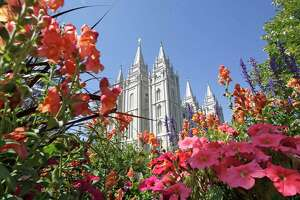 FILE - This Aug. 4, 2015 file photo, flowers bloom in front of the Salt Lake Temple, at Temple Square, in Salt Lake City. The Church of Jesus Christ of Latter-day Saints is repealing rules unveiled in 2015 that banned baptisms for children of gay parents and made gay marriage a sin worthy of expulsion. The surprise announcement Thursday, April 4, 2019, by the faith widely known as the Mormon church reverses rules that triggered widespread condemnations from LGBTQ members and their allies. (AP Photo/Rick Bowmer, File)