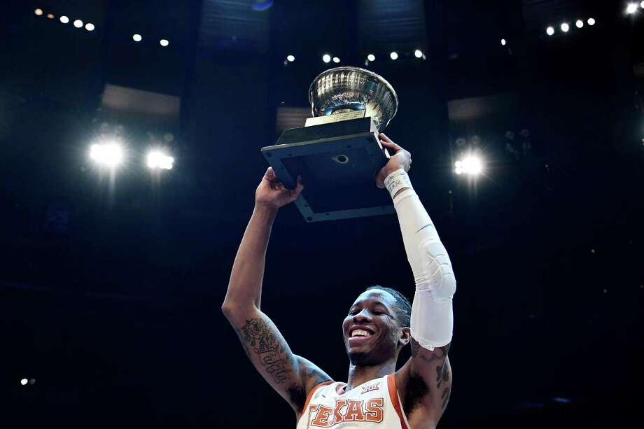Kerwin Roach II's 16 points and game-high nine assists helped UT win its second NIT trophy and first since 1978. Photo: Sarah Stier /Getty Images / 2019 Getty Images