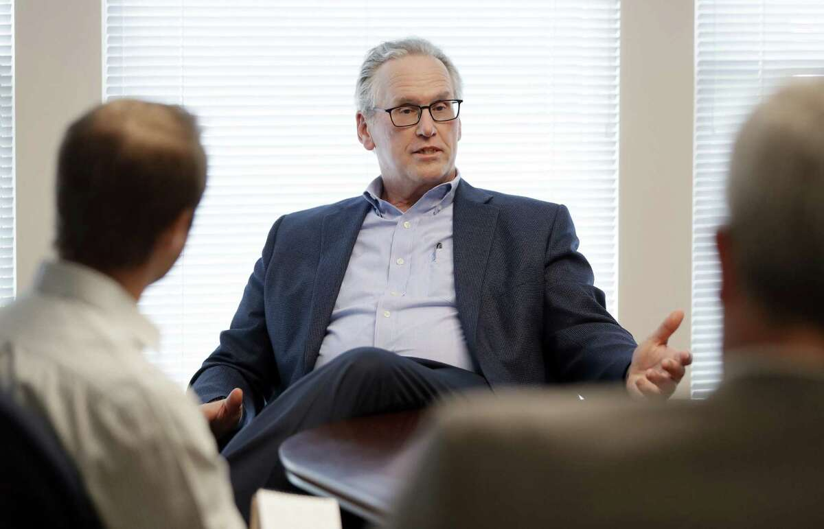 Bill Johnson, PG&E's new CEO, has spent nearly three decades in the energy business, but his commitment to renewable power has been criticized.