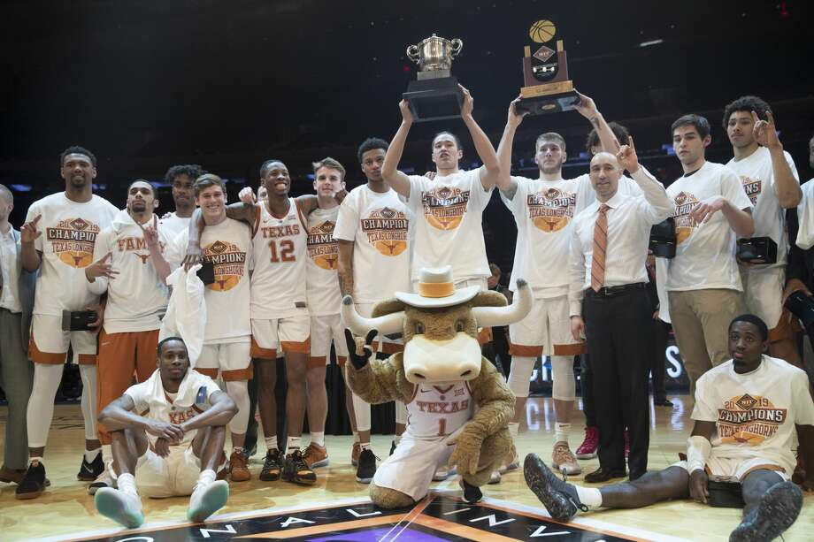 Texas players and coach Shaka Smart pose for photographers with their trophies after defeating Lipscomb during an NCAA college basketball game for the NIT championship Thursday, April 4, 2019, at Madison Square Garden in New York. Texas won 81-66. (AP Photo/Mary Altaffer) Photo: Mary Altaffer/Associated Press