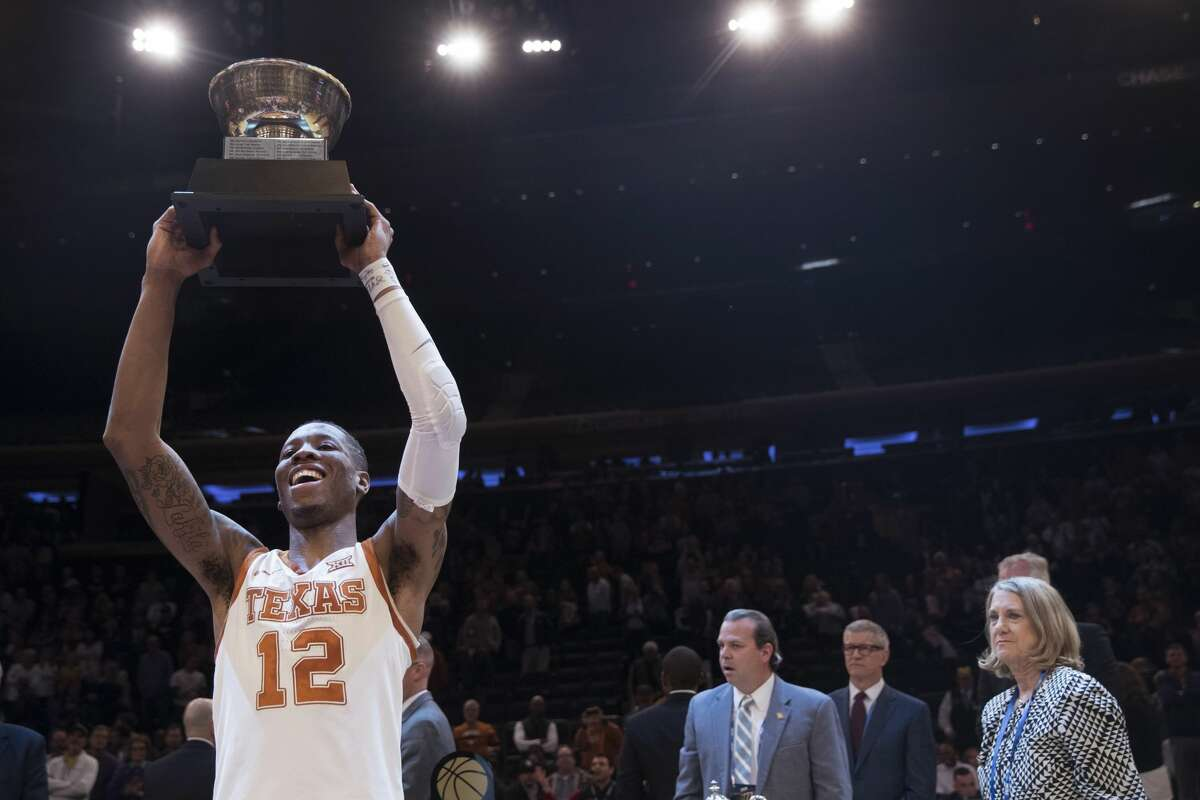 Texas guard Kerwin Roach II holds up the outstanding player award after Texas defeated Lipscomb 81-66 in an NCAA college basketball game for the NIT championship Thursday, April 4, 2019, at Madison Square Garden in New York. (AP Photo/Mary Altaffer)