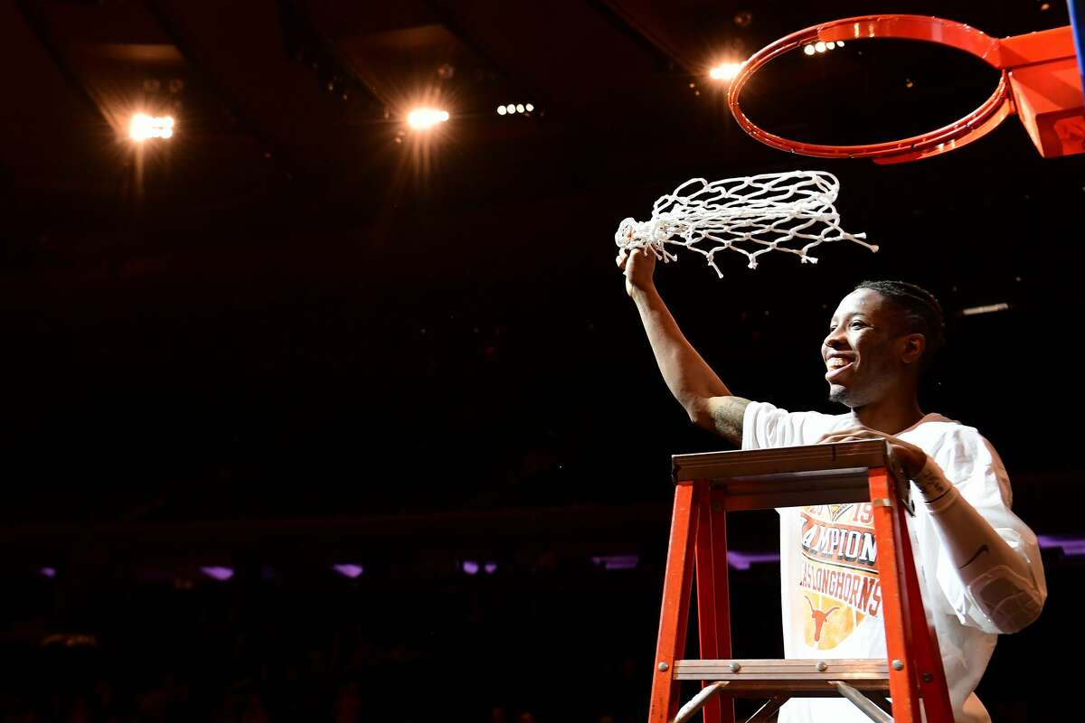 NEW YORK, NEW YORK - APRIL 04: Kerwin Roach II #12 of the Texas Longhorns cuts the net after the Texas Longhorns win 81-66 over the Lipscomb Bisons during the NIT Championship game at Madison Square Garden on April 04, 2019 in New York City. (Photo by Sarah Stier/Getty Images)