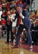 FILE - In this Feb. 16, 2019, file photo, Texas Tech coach Chris Beard yells at his players during the second half of an NCAA college basketball game against Baylor, in Lubbock, Texas. Beard was named The Associated Press Coach of the Year, Thursday, April 4, 2019. (AP Photo/Brad Tollefson, File)