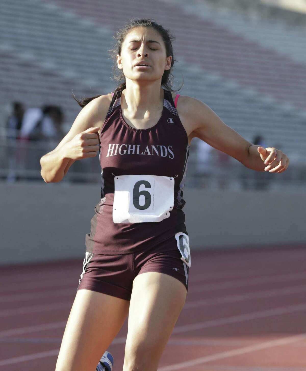 Highlands junior Astrid Gamez touches the finish line well ahead of all other competitors in the 800 meter race at the District 27-5A track meet at Alamo Stadium on April 4, 2019.