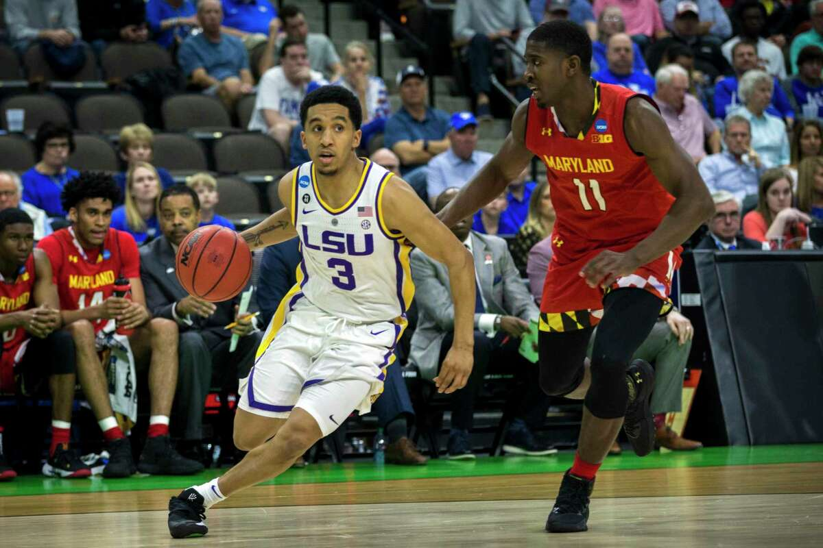 LSU guard Tremont Waters (3) brings the ball up court against Maryland guard Darryl Morsell (11) during the first half of the second round men's college basketball game in the NCAA Tournament, in Jacksonville, Fla. Saturday, March 23, 2019.
