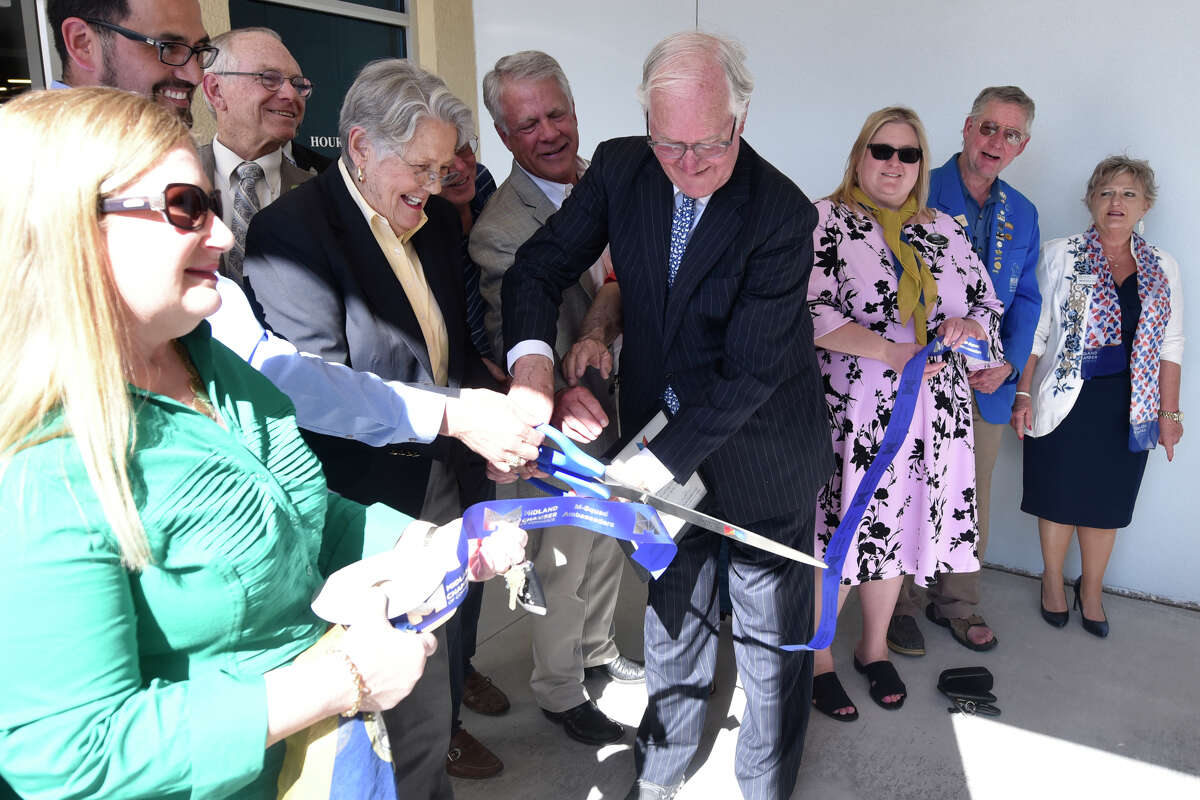 Rosalind Redfern Grover and former County Judge Mike Bradford cut the ribbon during a dedication ceremony April 4, 2019, at the newly renovated Library at the Plaza, formerly called the Midland County Public Library downtown branch. James Durbin / Reporter-Telegram