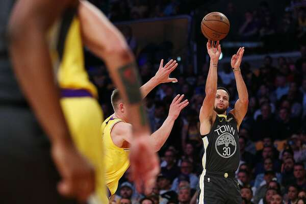 dd1026a42052 2of9Stephen Curry  30 of the Golden State Warriors shoots the ball against  Moritz Wagner  15 of the Los Angeles Lakers during the first half at  Staples ...