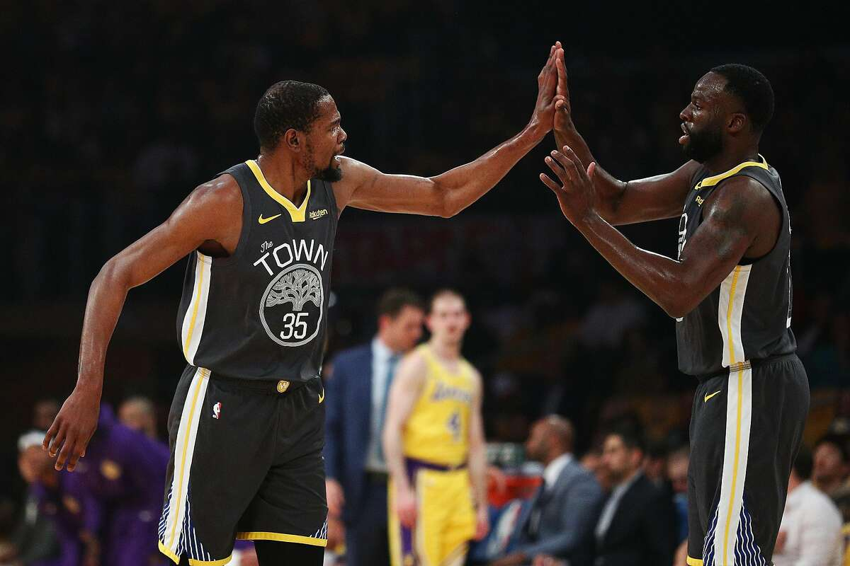 LOS ANGELES, CALIFORNIA - APRIL 04: Kevin Durant #35 of the Golden State Warriors and Draymond Green #23 celebrate after a play against the Los Angeles Lakers during the first half at Staples Center on April 04, 2019 in Los Angeles, California. NOTE TO USER: User expressly acknowledges and agrees that, by downloading and or using this photograph, User is consenting to the terms and conditions of the Getty Images License Agreement. (Photo by Yong Teck Lim/Getty Images)
