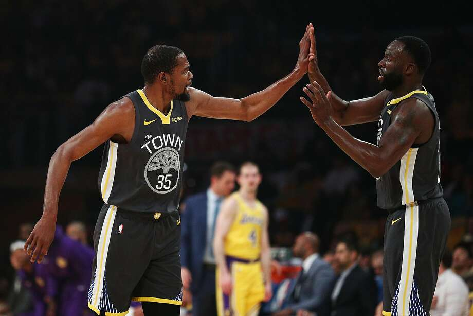 LOS ANGELES, CALIFORNIA - APRIL 04: Kevin Durant #35 of the Golden State Warriors and Draymond Green #23 celebrate after a play against the Los Angeles Lakers during the first half at Staples Center on April 04, 2019 in Los Angeles, California. NOTE TO USER: User expressly acknowledges and agrees that, by downloading and or using this photograph, User is consenting to the terms and conditions of the Getty Images License Agreement. (Photo by Yong Teck Lim/Getty Images) Photo: Yong Teck Lim / Getty Images