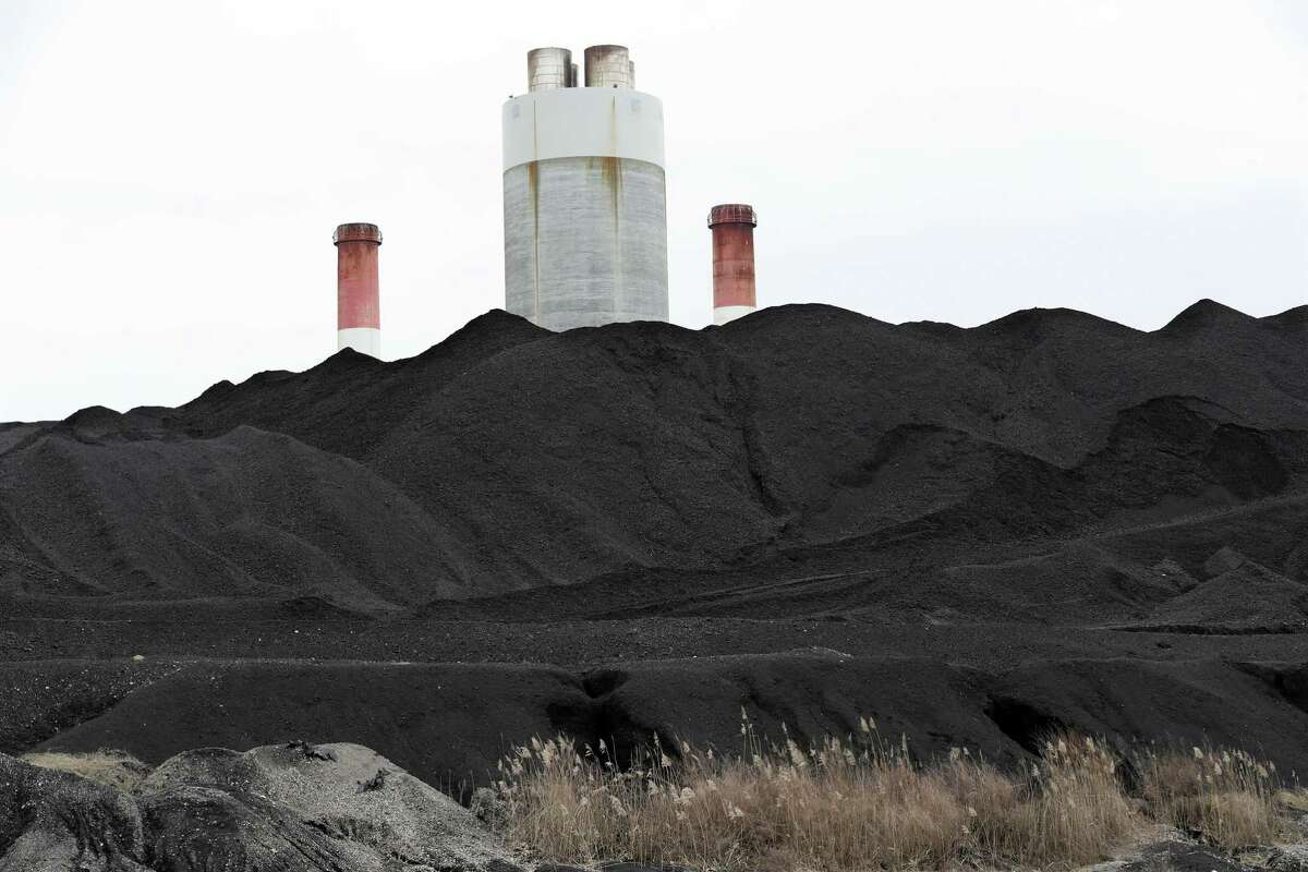 Coal piled at the Gallatin Fossil Plant in Gallatin, Tenn. Environmental groups have said the Tennessee Valley Authority, where Johnson was most recently CEO, has polluted the Cumberland River with waste from the plant.