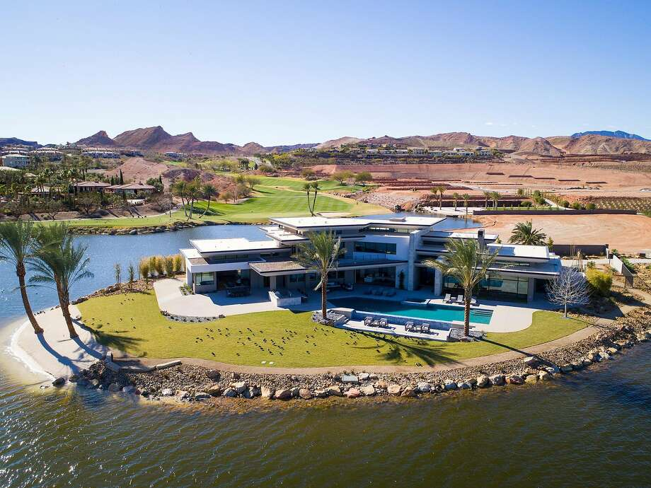 This aerial shot of 23 Summer House Drive in Henderson, Nev., showcases the home's 300 feet of waterfront. Photo: John Martorano