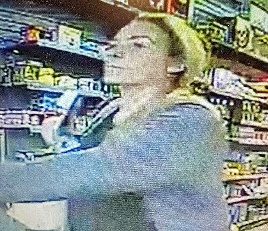 The Danbury Police Department is requesting the public's help in identifying a suspect in a vehicle burglary. At approximately 7 p.m. on Thursday, April 4, 2019, a vehicle was burglarized at a business located in the area of Backus and Kenosia avenues. The female in photos released by police is wanted for questioning regarding the use of a credit card taken from the vehicle. Photo: Danbury Police Department Photo