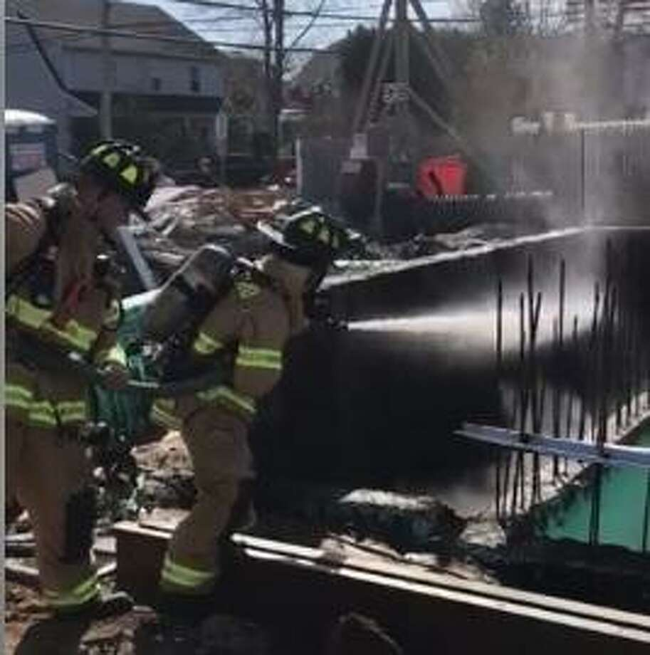 "Quick action by Stamford firefighters Thursday, April 4, 2019 stopped two fires from spreading and doing more damage. Engine 4 personnel prevented a fast-moving construction material fire from extending to adjacent homes on Cove Road. ""The fire involved pre-cast foam insulated foundation blocks and spread to other construction materials on the very compact site,"" the Stamford Fire Department posted on its Facebook page. Photo: Stamford Fire Department Photo"